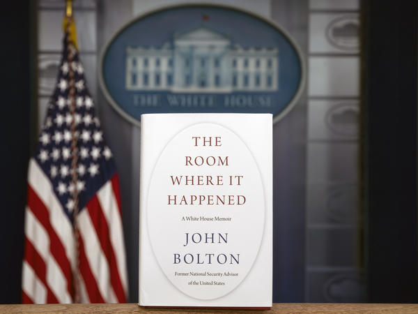 A copy of John Bolton's new book, <em>The Room Where It Happened</em>, stands in the White House briefing room. On Saturday, a federal judge declined the Trump administration's request to block the publication of the former national security adviser's book.