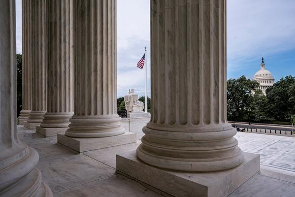 In this June 15, 2020, file photo the columns of the Supreme Court are seen with the Capitol at right, in Washington, D.C.. .