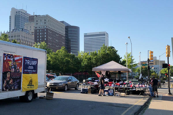 Pop-up retailers sell Trump merchandise near BOK Center in Tulsa on Thursday, June 18, 2020.