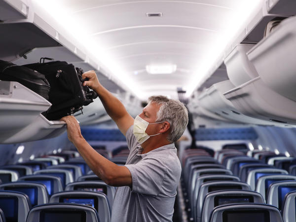 A passenger wears personal protective equipment on a Delta Air Lines flight after landing at Minneapolis−St. Paul International Airport in late May.
