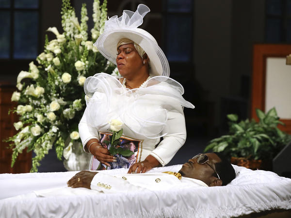 Tomika Miller weeps over her husband Rayshard Brooks as his coffin is closed at the conclusion of his public viewing at Ebenezer Baptist Church in Atlanta on Monday.