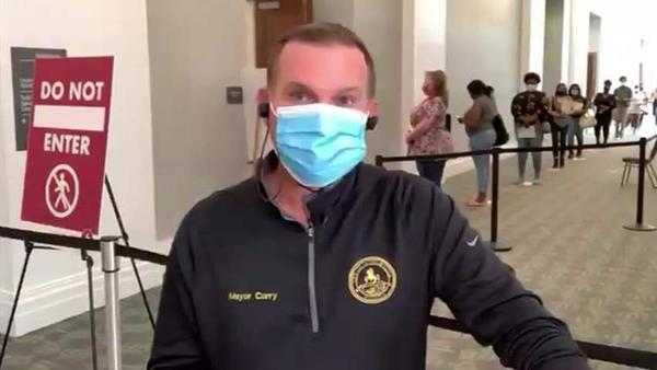 Mayor Lenny Curry is pictured wearing a mask recently at the Main Library branch in Downtown Jacksonville.