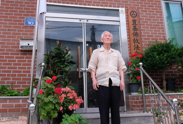 Park Tae-seung stands outside his office and prayer hall in Yeongju, South Korea. Now 87, Park was 17 when he was recruited to fight in the Korean War.
