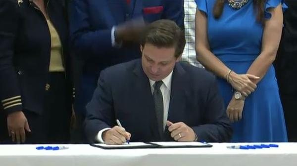 Gov. Ron DeSantis on Wednesday formally signed legislation that will allocate $500 million to increase the minimum salaries for teachers in Florida.