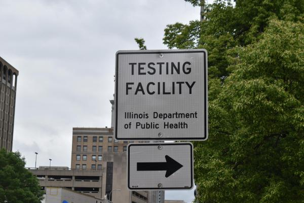 A sign on Main Street in downtown Peoria directs people to the IEMA COVID-19 testing site set up in the Peoria Civic Center's Fulton Street parking lot.