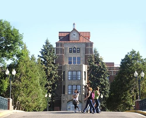 Students walk past Mullen Hall at Montana State University Billings.