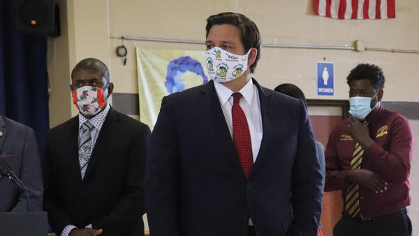 Governor Ron DeSantis said everyone at the bill signing was wearing a mask because 6 feet of social distancing was not possible.