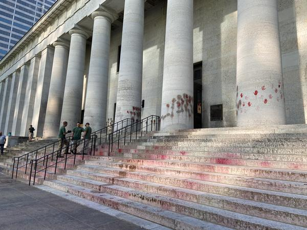 Hand prints in red paint were left on the west columns and stairs at the Ohio Statehouse as part of a protest on June 18.