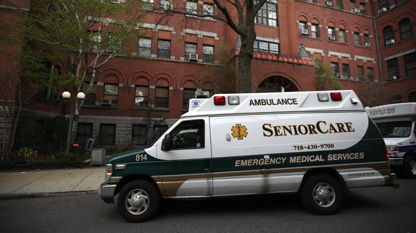 An ambulance pulls up outside a nursing home in Brooklyn, N.Y. Two senators have called for an investigation of five states, including New York, which ordered nursing homes to admit patients who tested positive for COVID-19.