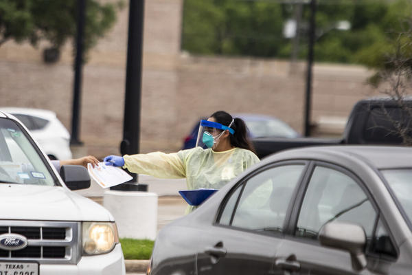 Drive-thru screening at a CommUnityCare Clinic in Austin during the coronavirus pandemic.