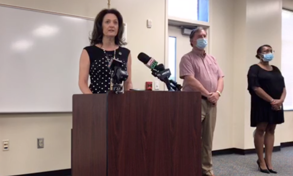 Union County School Board chair Melissa Merrell speaks Monday at a press conference announcing the resignation of Travis Kiker from the board.