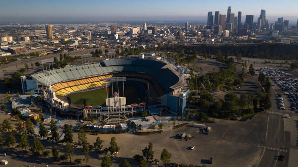 Dodger Stadium in Los Angeles stands empty in an aerial view from late May. Games will resume in late July.
