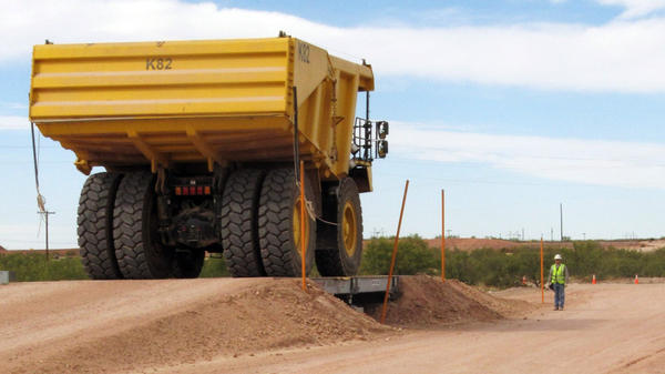 A large earth-mover carries PCB-contaminated soil from the Hudson River in New York to a burial pit at Waste Control Specialists near Andrews, Texas, in October 2009.