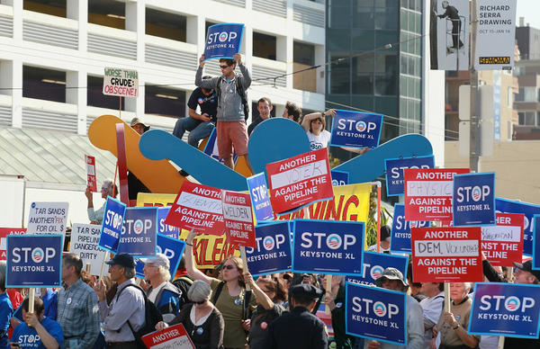 Protesters demonstrate last month against the construction of the Keystone XL oil pipeline outside the W Hotel in San Francisco, before the arrival of President Obama, who was holding a fundraiser.