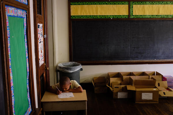 Third-grader Kassim West last July at Walter G. Smith Elementary School, one of more than 20 Philadelphia public schools that closed at the end of the school year.