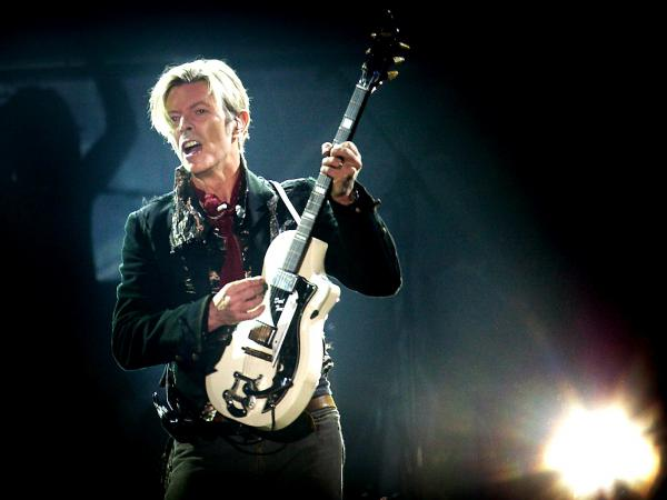 Bowie performs on stage at the Forum in Copenhagen in 2003.