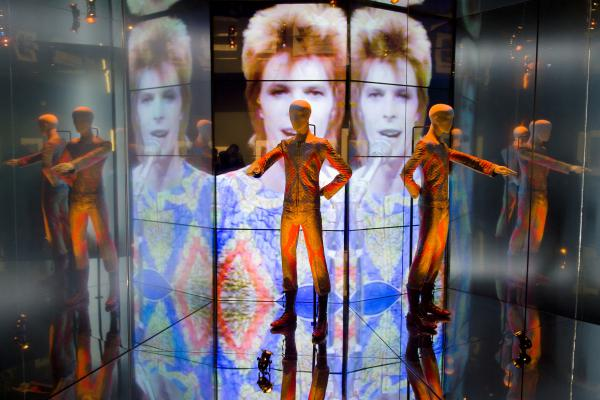 """The """"Starman"""" costume from David Bowie's appearance on """"Top of the Pops"""" in 1972 is displayed at the """"David Bowie is"""" exhibition at the Victoria and Albert museum in London on March 20, 2013. The exhibition featured more than 300 objects, including handwritten lyrics, original costumes, fashion, photography, film, music videos, set designs and Bowie's own instruments."""