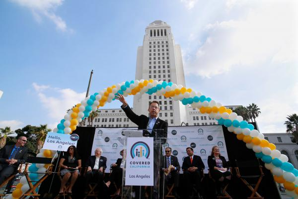 Peter Lee, executive director of Covered California, speaks during an enrollment event in Grand Park, in front of Los Angeles City Hall, on Nov. 14.