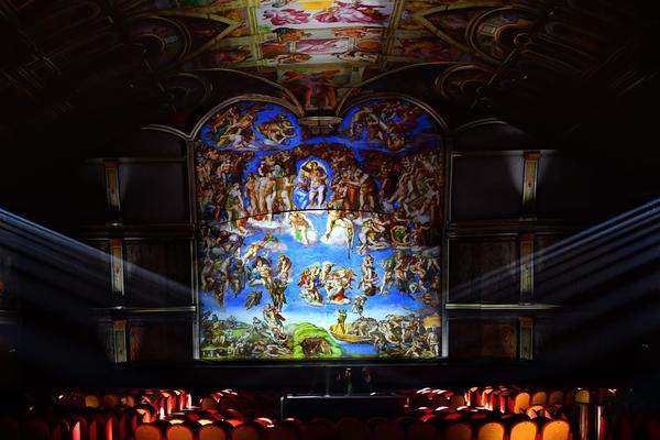 Technicians attend a rehearsal of the show <em>Universal Judgment: Michelangelo and the Secrets of the Sistine Chapel</em>, directed by Marco Balich, on March 13 near the Vatican. The Vatican Museums, which house the Sistine Chapel, provided high-definition digital reproductions of the frescoes in the hall at a reduced rate because they acknowledged the educational value of the project.