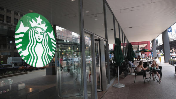 Customers sit on the patio of a Chicago Starbucks store after it was closed on May 29.