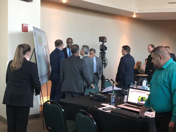 Broward County schools superintendent Robert Runcie is surrounded by members of the Marjory Stoneman Douglas High School Public Safety Commission.