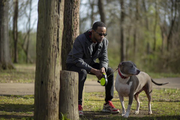 Shawn Esco brings his dog Nibbler to a park in Jackson, Miss. He was diagnosed with HIV 11 years ago and has stayed healthy, but the same can't be said of many of the other HIV-positive people in his life.