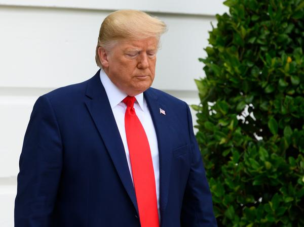 Three federal judges on Friday temporarily blocked a Trump administration rule that would make it harder for low-income immigrants to get a green card. President Trump is seen here leaving the White House last week.