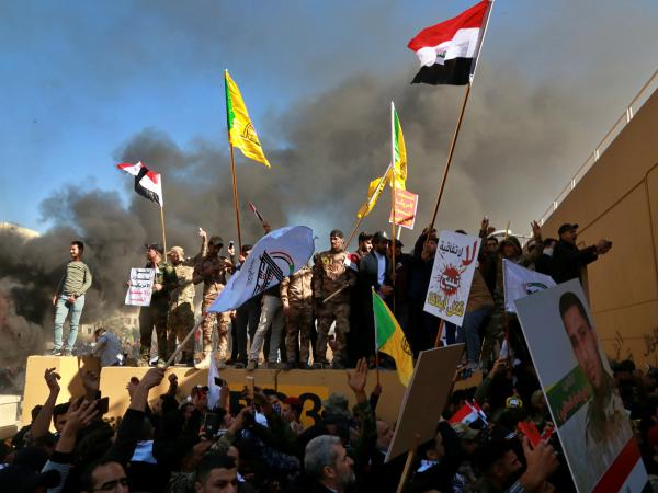 Protesters set fires in front of the U.S. Embassy compound in Baghdad on Tuesday.