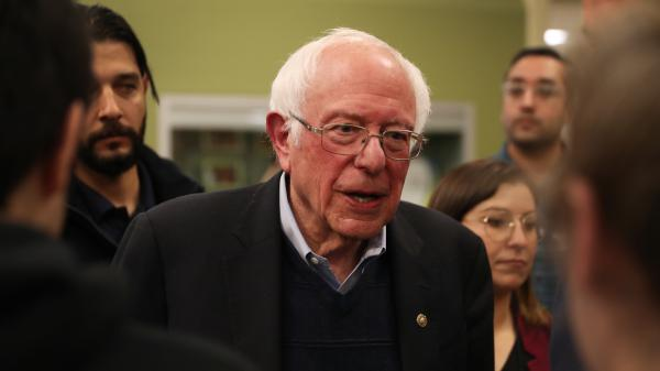 Sen. Bernie Sanders of Vermont greets people during a campaign event in Winterset, Iowa, on Dec. 30. His campaign announced on Thursday that it had raised $34.5 million in the last fundraising quarter.