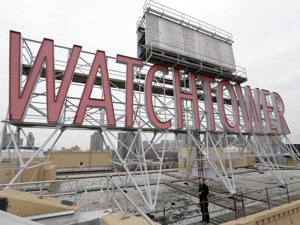 Two women who were sexually abused as children say the Jehovah's Witnesses failed to report their abuser to authorities in Montana and instead expelled him from the congregation as punishment until he repented. Pictured, in 2015, is a sign atop the then-world headquarters of the Jehovah's Witnesses in New York.