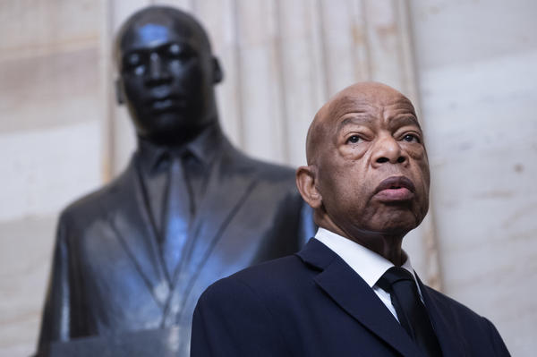 Georgia Rep. John Lewis near the statue of Martin Luther King Jr. in the Capitol Rotunda in Washington, D.C., earlier this year. At StoryCorps in 2018, Lewis talked about meeting King in Montgomery, Ala., at 18.