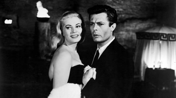 Italian actor Marcello Mastroianni and Swedish actor Anita Ekberg hold hands in a scene from Federico Fellini's 1960 film <em>La Dolce Vita.</em>