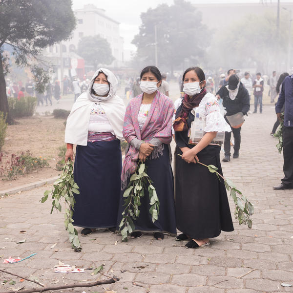 Tree women of the Otavalo indigenous community of Ecuador stand on the Arbolito park in Quito, Ecuador during the 10th day of social protests that took place in October, 2019.