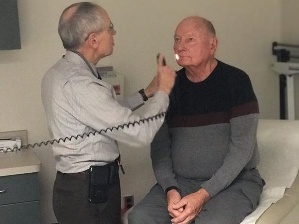 Dr. Ala examines a patient.