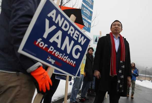Democratic presidential candidate Andrew Yang greets supporters in front of a polling station on Feb. 11 in Keene, N.H.