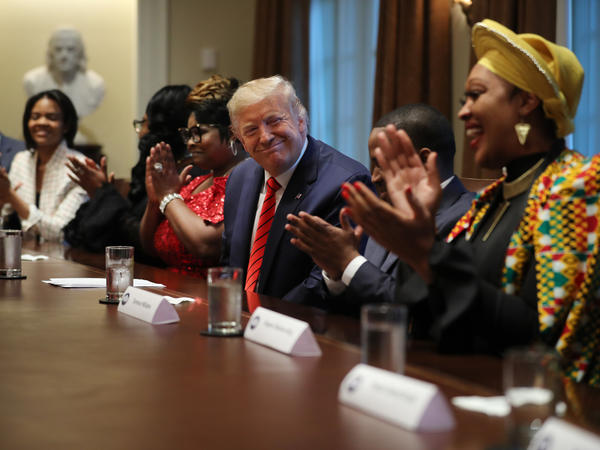 President Trump smiles at Angela Stanton-King at an African American history event at the White House. A few days later, Stanton-King was a speaker at a Black Voices for Trump event in Milwaukee.