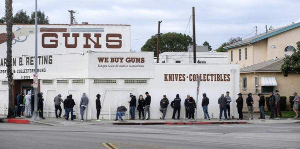 People wait in a line to enter a gun store in Culver City, Calif., on March 15, 2020. Coronavirus concerns have led to consumer panic buying of grocery staples, and now gun stores are seeing a similar run on weapons and ammunition as panic intensifies.
