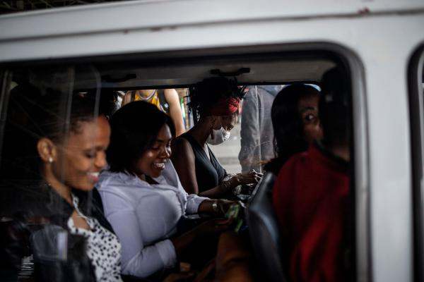 A woman wears a mask as a preventive measure inside a minibus taxi in Johannesburg.