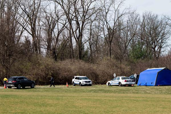 Drive-through tests for COVID-19 take place in medical tents on Temple University's Ambler Campus in Montgomery County, Pa. There was a threat that this site would close, but testing will continue.