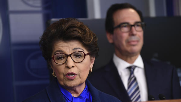 Jovita Carranza, head of the Small Business Administration, speaks as U.S. Treasury Secretary Steven Mnuchin listens during a news conference on April 2. The SBA has notified nearly 8,000 businesses that their information may have been exposed.