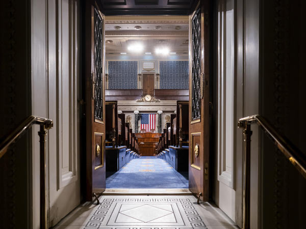The chamber of the House of Representatives is seen at the Capitol in Washington. Leaders are discussing next steps for how to conduct business like voting and committee hearings during the coronavirus pandemic.