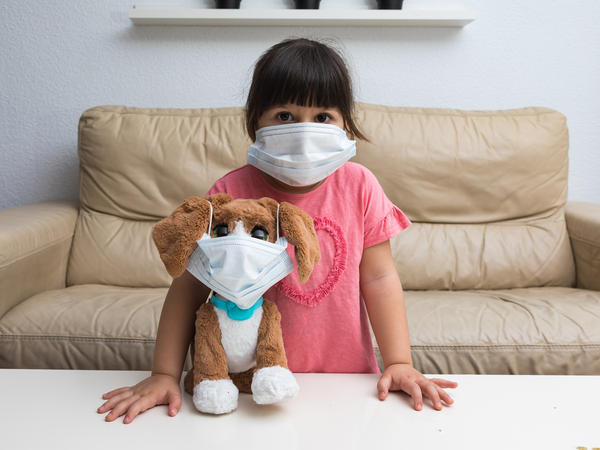On Sunday, children in Spain will be allowed to go outside for the first time in nearly six weeks. Here, Olimpia, 3 (the photographer's daughter), plays with her toy dog as they wear face masks in Madrid.