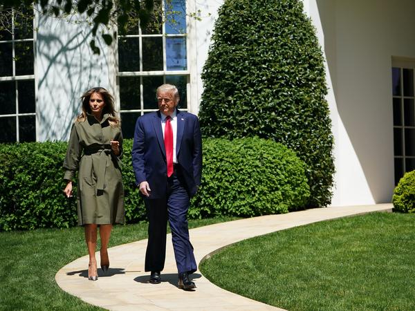 President Trump and first lady Melania Trump take part in a ceremony at the White House to mark Earth Day.