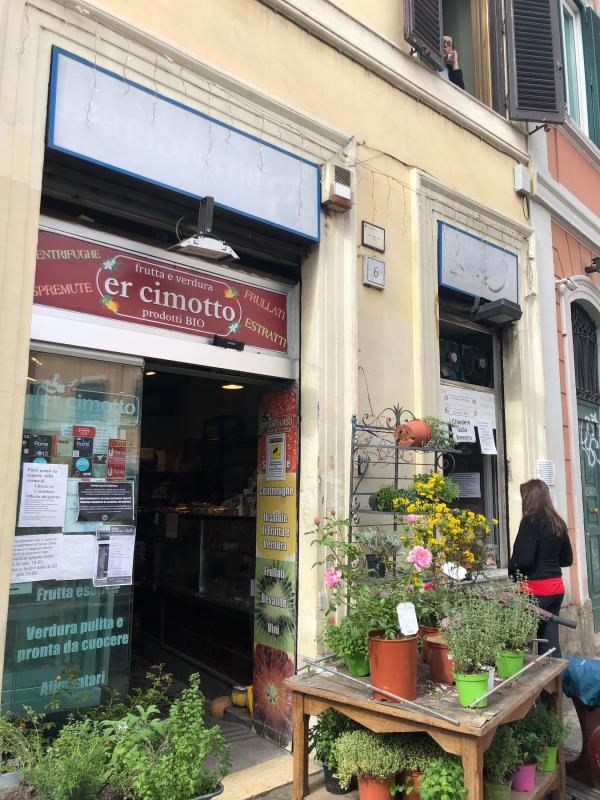 A customer places her order at the window of the Er Cimotto grocery shop in Rome. Suspended shopping is an act of charity in which the donor doesn't show off and the recipient doesn't have to show gratitude.