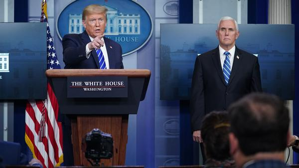 President Trump, flanked by Vice President Pence, speaks during the daily briefing on the novel coronavirus at the White House on Thursday.