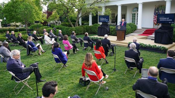 Reporters listen to President Trump as he speaks during a news conference on the novel coronavirus in the Rose Garden of the White House Monday.