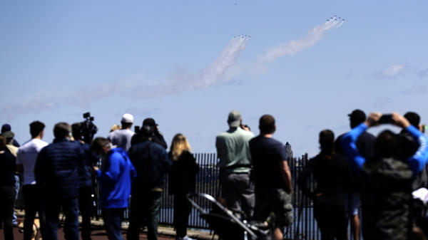 The Blue Angels and Thunderbirds military flight teams drew spectators in their pass over New York City on Tuesday to salute first responders.