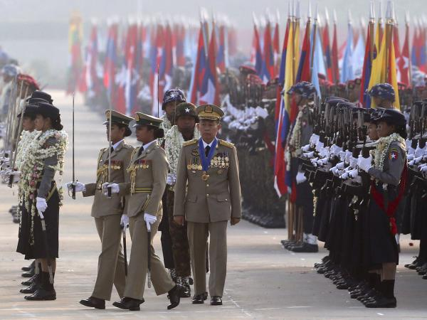 Myanmar military deputy Commander in Chief, Vice Senior Gen. Soe Win, center, inspects military officers on Armed Forces Day last year. A U.N. human rights monitor is accusing the military of war crimes and crimes against humanity.