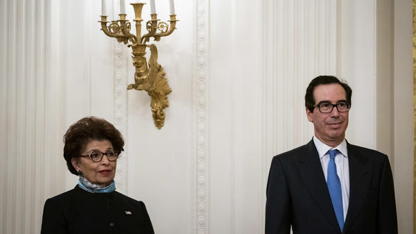Jovita Carranza, head of the U.S. Small Business Administration, and Treasury Secretary Steven Mnuchin attend a Paycheck Protection Program event at the White House on Tuesday.
