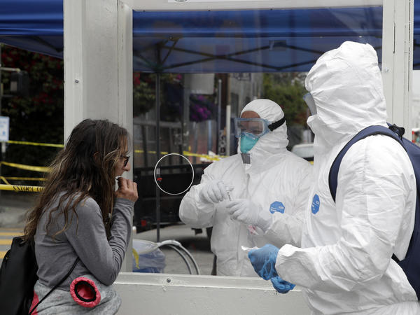 A woman gets a novel coronavirus test in Los Angeles earlier this month. The City of Los Angeles, in partnership with Los Angeles County, will offer free coronavirus testing to all residents regardless of whether they have symptoms.